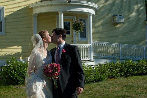 bride and groom kiss after their wedding at the Governor's House