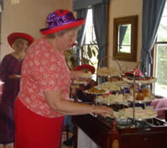 Red Hat tea party in tea room at Governor's House in Hyde Park, Vermont