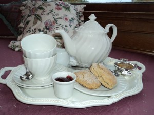 tray with tea pot and scones