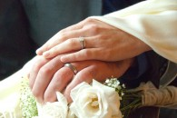 hands with wedding rings of newly-married couple