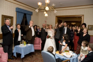 Wedding party and guests making a champagne toast