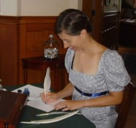Yound woman writing with a quill pen