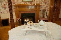 bedtray with tea and scones and fireplace in the background