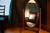 bedroom reflected in antique mirror