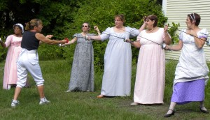 ladies in Regency period dress have a beginners' fencing lesson