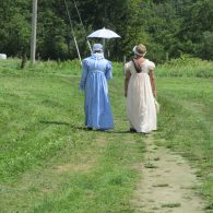 two ladies in Regency period costume taking a walk