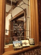 leaded-glass window peeks through showing library